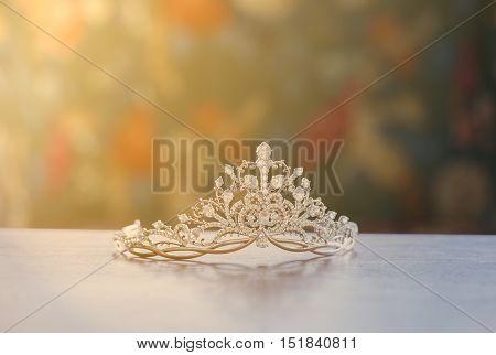 Beautiful tiara with sun shine on the table