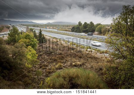 landscape with a highway on a cloudy day in Autumn