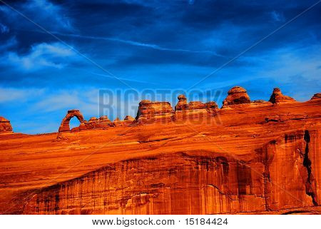 A very vibrant colored landscape photo of Delicate Arch at Arches National Park. poster