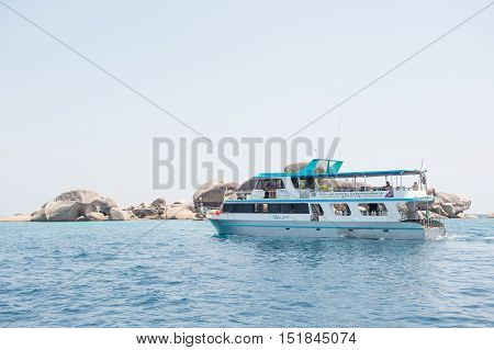 Pang-nga, Thailand - Mar 3, 2015: Passenger Boats Take Tourists Visit The Island Rock In The Andaman