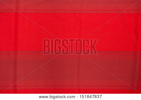 Crumpled fabric texture red cloth background , colour
