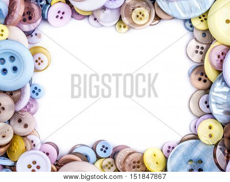 Framework arranged from apparel buttons in different size and colors with white copy space