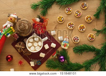 Christmas cocoa with marshmallow and homemade cookies with chocolate and nuts, with decorations. New year hot drink. Merry Christmas evening beverage.