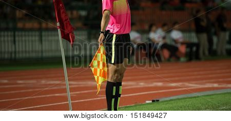 Assistant football referee and Referee's flag signal corner kick