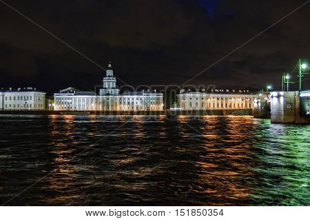 Saint-Petersburg, Russia - May 16, 2006: Neva river and the University Embankment with the building of the Cabinet of curiosities in St.Petersburg, Russia.