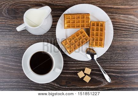 Black Coffee With Viennese Waffles And Jug Milk On Table