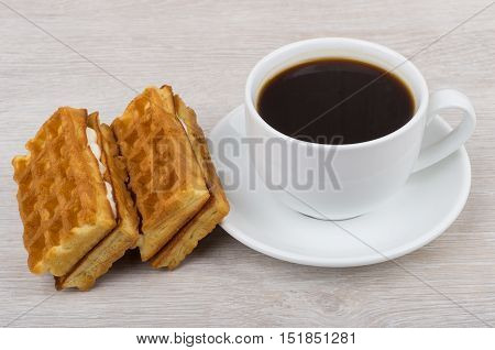 Black Coffee And Viennese Waffles On Table