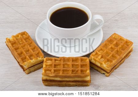 Black Coffee And Three Viennese Waffles On Table