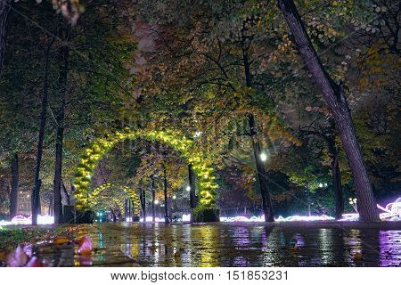 Passion Boulevard Moscow Russia. Street decoration in the form of light arches and autumnal trees at night.