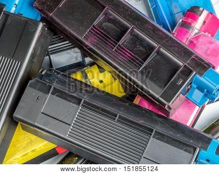 Pile of used color laser printer toner cartridges