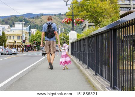 Father and little daughter walking in Nelson city of New Zealand