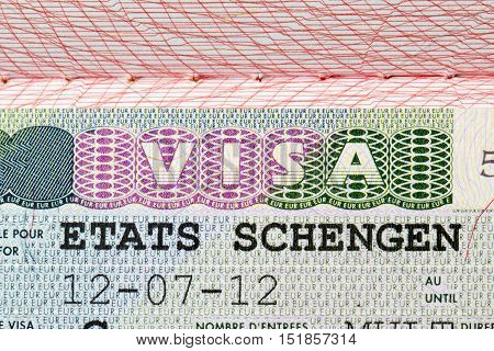Schengen european visa stamp on passport page