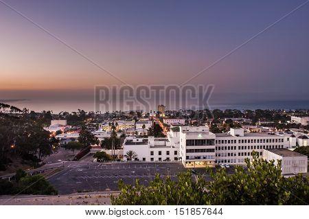 Night lights of Ventura glow under the predawn sky.