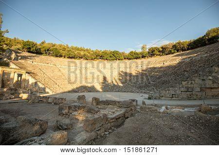 Ancient Theatre of Epidaurus in Greece in sunset
