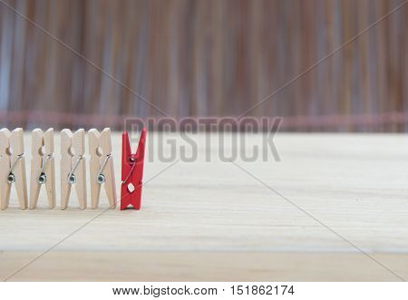 wooden clothes pin Unlike the red on wood table