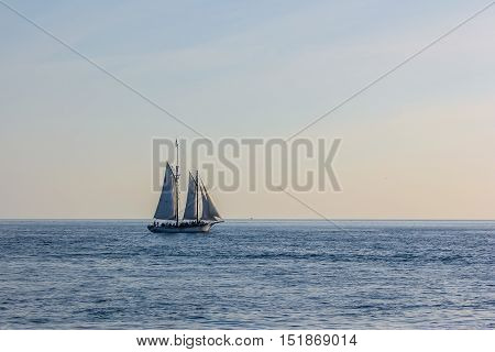 Sailing ship in the Atlantic Ocean at sunset, Key West, Florida Keys, Florida, United States. The boats for the Sunset Celebration starts from Mallory Square. Sunset Sailing in Key West Florida