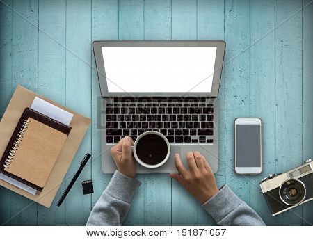 Business office with computer,note book,phone,camera and coffee cup in wood background.copy space.
