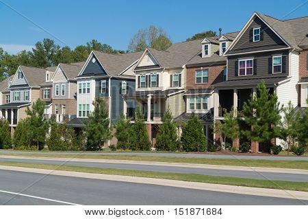 Row of town homes along a parkway