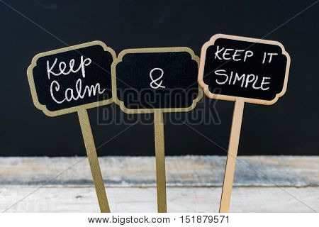 Keep Calm And Keep It Simple Message Written With Chalk On Mini Blackboard Labels
