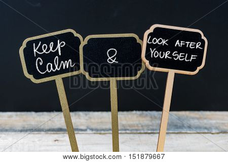 Keep Calm And Look After Yourself Message Written With Chalk On Mini Blackboard Labels