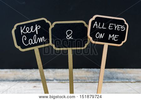 Keep Calm And All Eyes On Me Message Written With Chalk On Mini Blackboard Labels