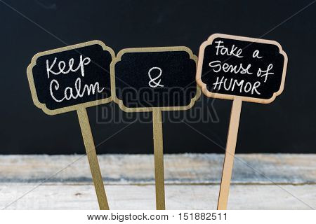 Keep Calm And Fake A Sense Of Humor Message Written With Chalk On Mini Blackboard Labels