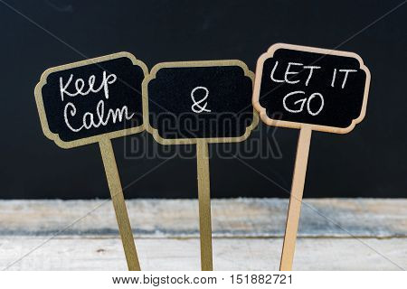 Keep Calm And Let It Go Message Written With Chalk On Mini Blackboard Labels