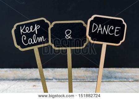 Keep Calm And Dance Message Written With Chalk On Mini Blackboard Labels