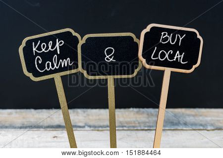Keep Calm And Buy Local Message Written With Chalk On Mini Blackboard Labels