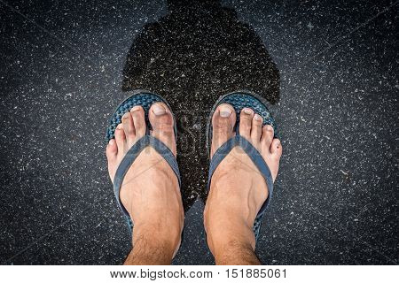Top View Feet In Sandals Selfie Shot Of Asian Men Legs With Wet Street