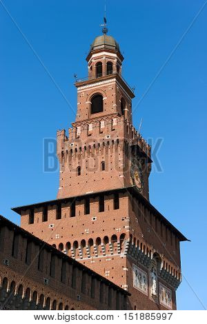 Detail of the clock tower of the Sforza Castle XV century (Castello Sforzesco). It is one of the main symbols of the city of Milan Lombardy Italy