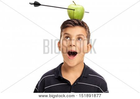 Overjoyed little boy looking at an apple pierced by an arrow on his head isolated on white background