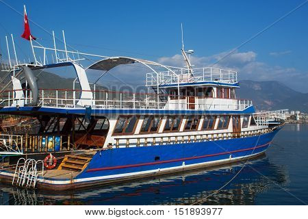 Small wooden sailing ship for marine tourist trips along the coast of Alanya. Boat tours is a very popular form of recreation in the Mediterranean. poster