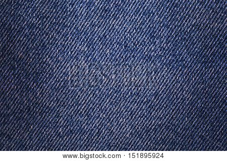 Texture denim. Cloth rough worn with small defects slight darkening at the corners. Realistic fabric pattern for all purposes