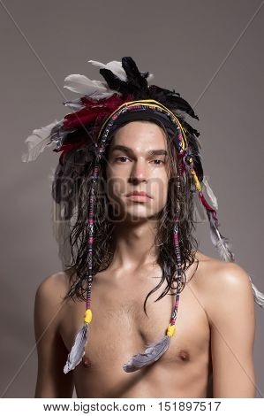 One Young Man Posing Shirtless War Bonnet Hairstyle