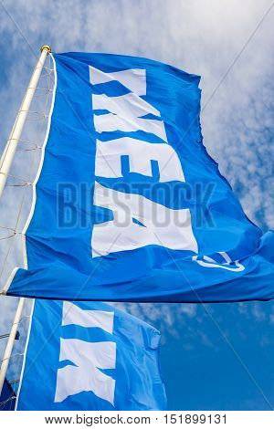 SAMARA RUSSIA - SEPTEMBER 25 2016: IKEA flags waving on wind against a blue sky near the IKEA Samara Store. IKEA is the world's largest furniture retailer
