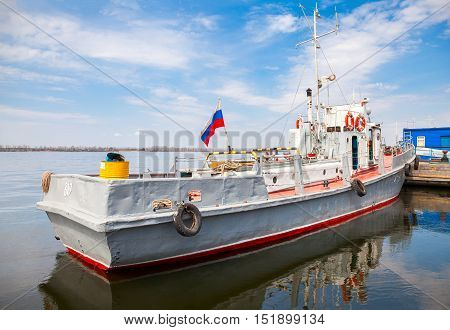 SAMARA RUSSIA - MAY 1 2015: The small ship is at the quay wall of the river port in sunny day