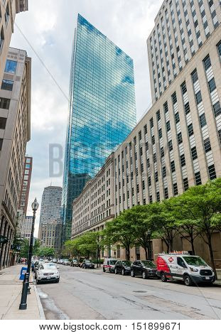 Boston, Massachusetts - June 2016, USA: One of the famous Boston skyscrapers - John Hancock Tower, view from Stuart Street