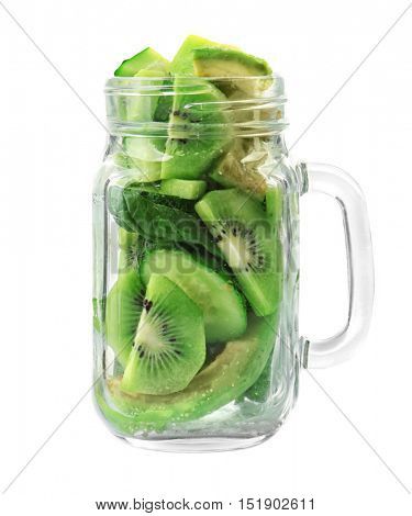 Fresh ingredients for delicious smoothie in glass jar on white background, closeup