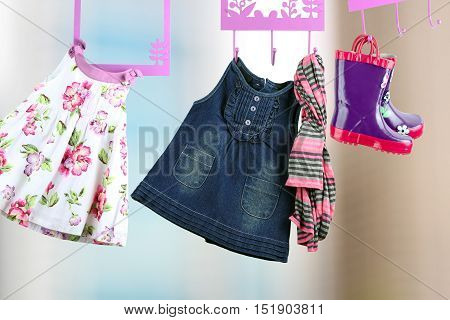 Fashion baby dresses hanging on a hanger