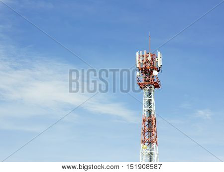 Close up antenna repeater tower on blue sky.