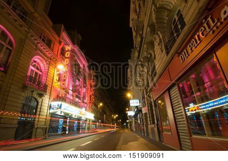 Traffic Lights And Night View Of The Theatre Megador, Paris.