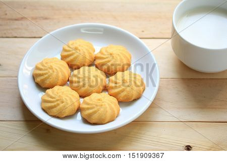delicious Cookies and milk in white cup
