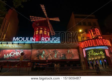 Moulin Rouge Is A Famous Cabaret And Thater In Paris, France.