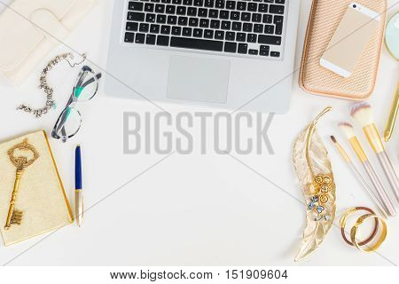 Laptop keyboard with golden woman accessories mock up flat lay styled scene, top view, copy space on white table background