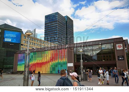 OSLO NORWAY - AUGUST 18 2016: People visit Oslo Central Station (Norwegian: Oslo sentralstasjon) is the main railway station in Oslo Norway on August 182016.