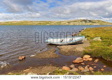 Boat In A Lake In Hardangervidda National Park, Norway