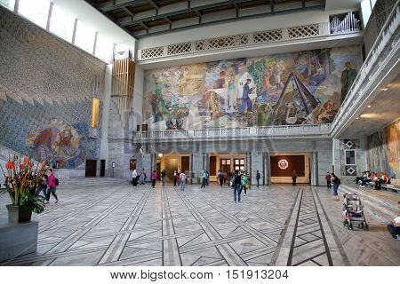 OSLO NORWAY - AUGUST 18 2016: Tourists visit in interior of the Oslo City Hall in Oslo Norway on August 182016.