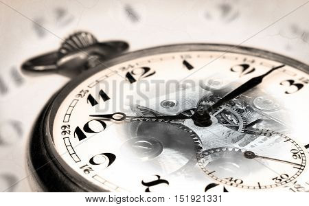 Old swiss pocket watch montage with transparent clock face and vintage clock face background