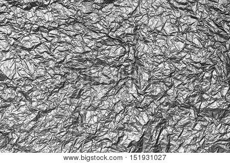 Discolored design background of crinkled silver foil